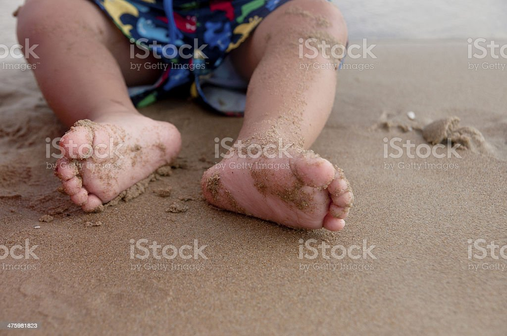 Baby Boy playing at the Beach stock photo