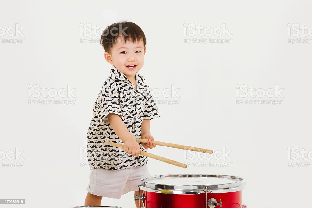 Baby boy playing drums stock photo