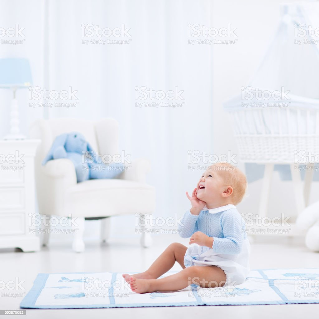 Baby boy playing in bedroom stock photo