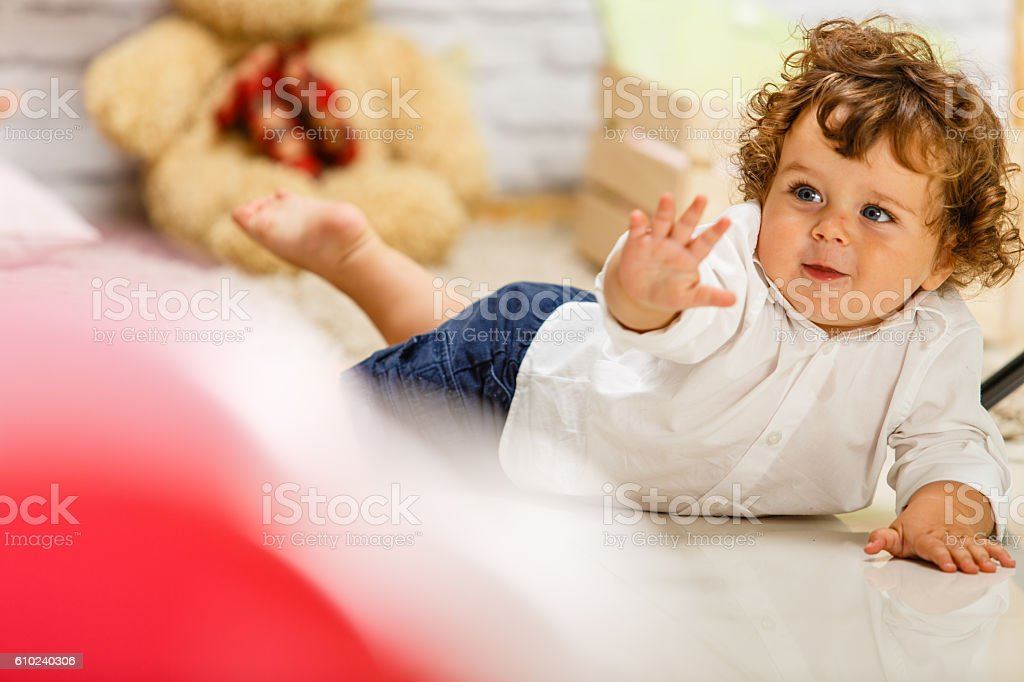 Baby boy playing on the floor stock photo