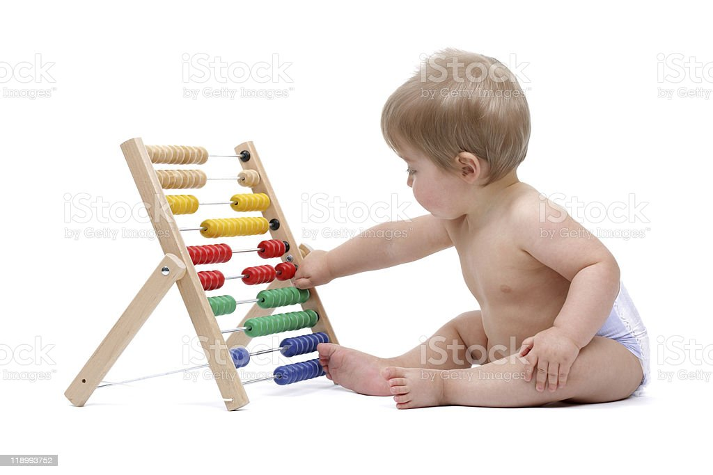 Baby boy playing with abacus stock photo