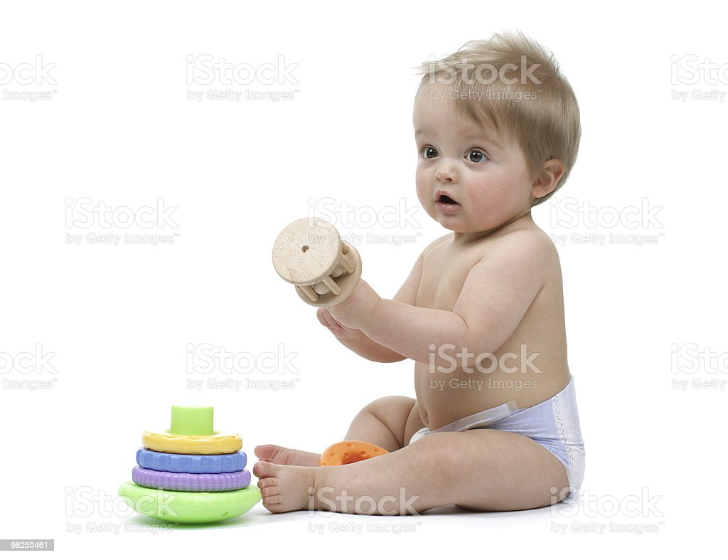 Baby boy playing with his toys royalty-free stock photo