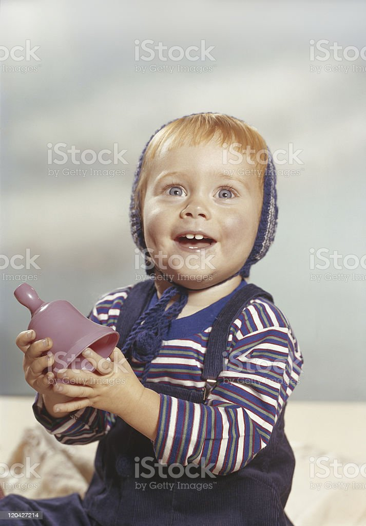 Baby boy playing with toy, smiling royalty-free stock photo