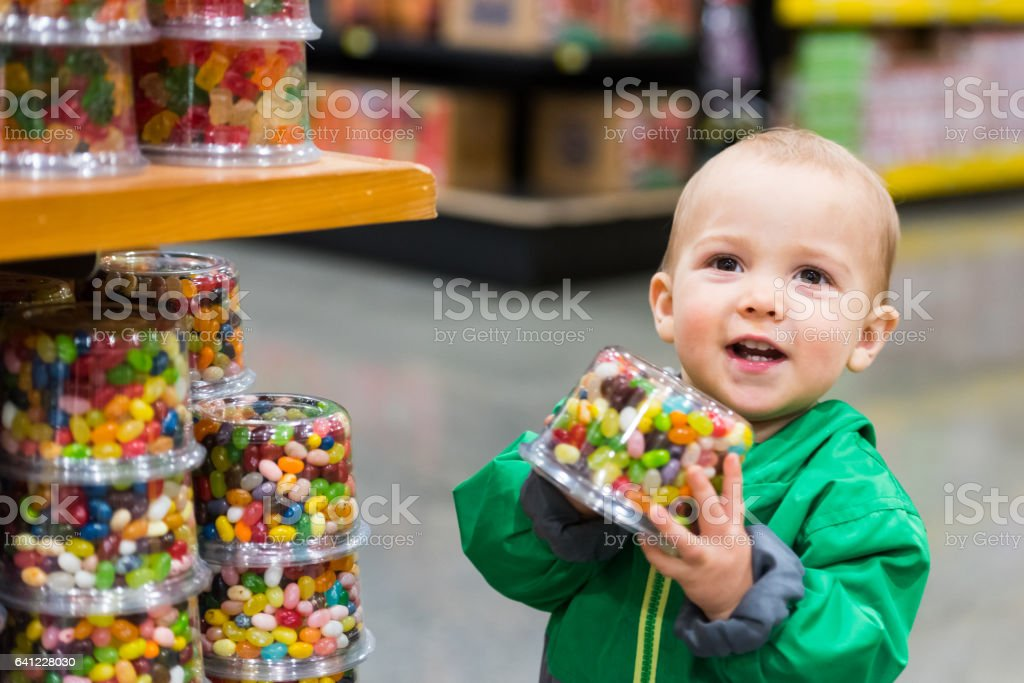 Baby Boy shopping for candies stock photo