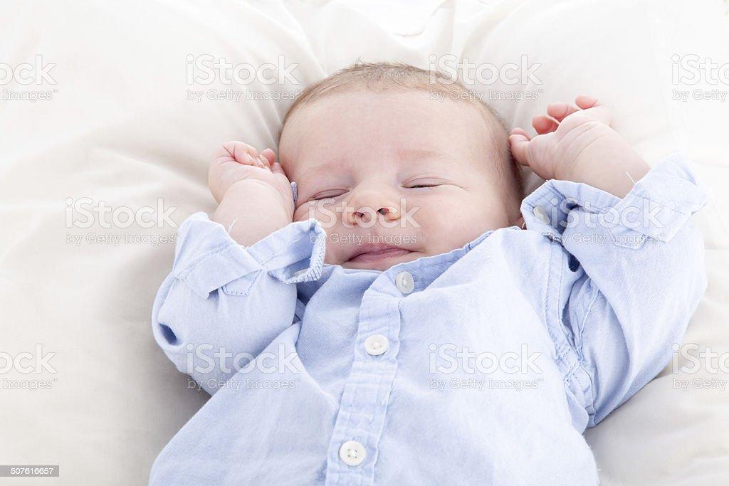 Baby boy sleeping on the bed stock photo