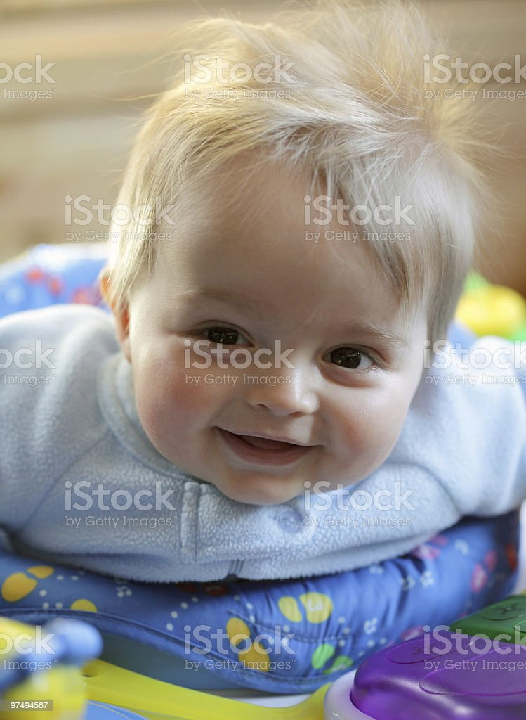 Baby boy smiling and playing stock photo