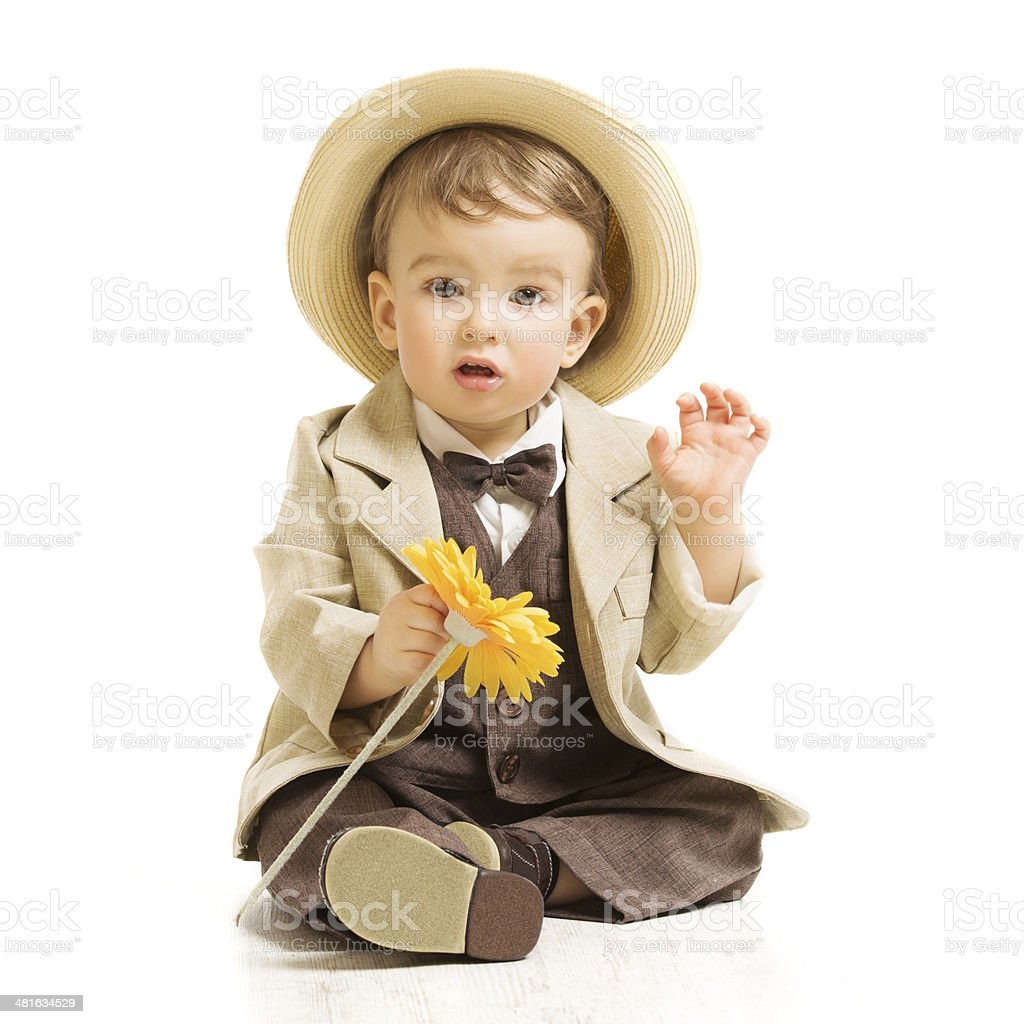 Baby boy well dressed in suit with flower, vintage children stock photo