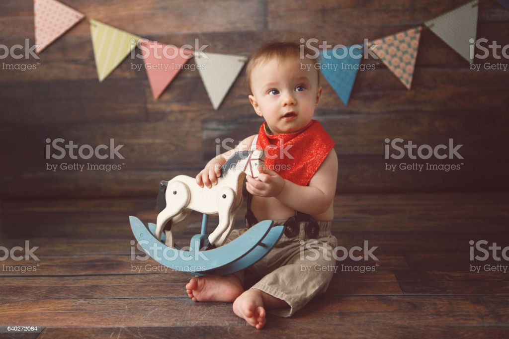 Baby Boy with a Toy Rocking Horse stock photo
