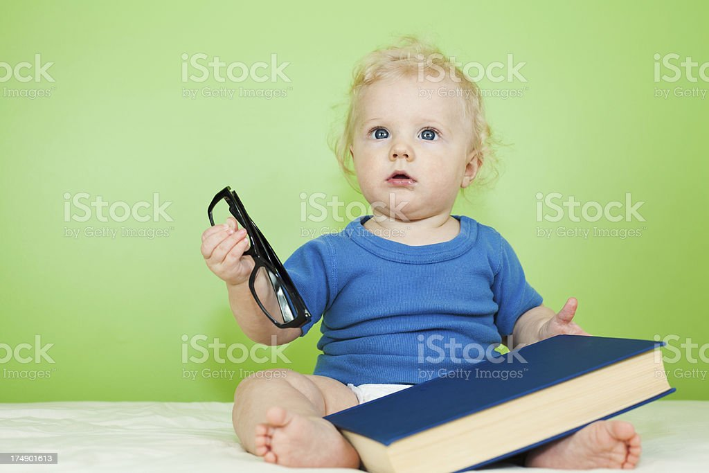 Baby boy with book and glasses royalty-free stock photo