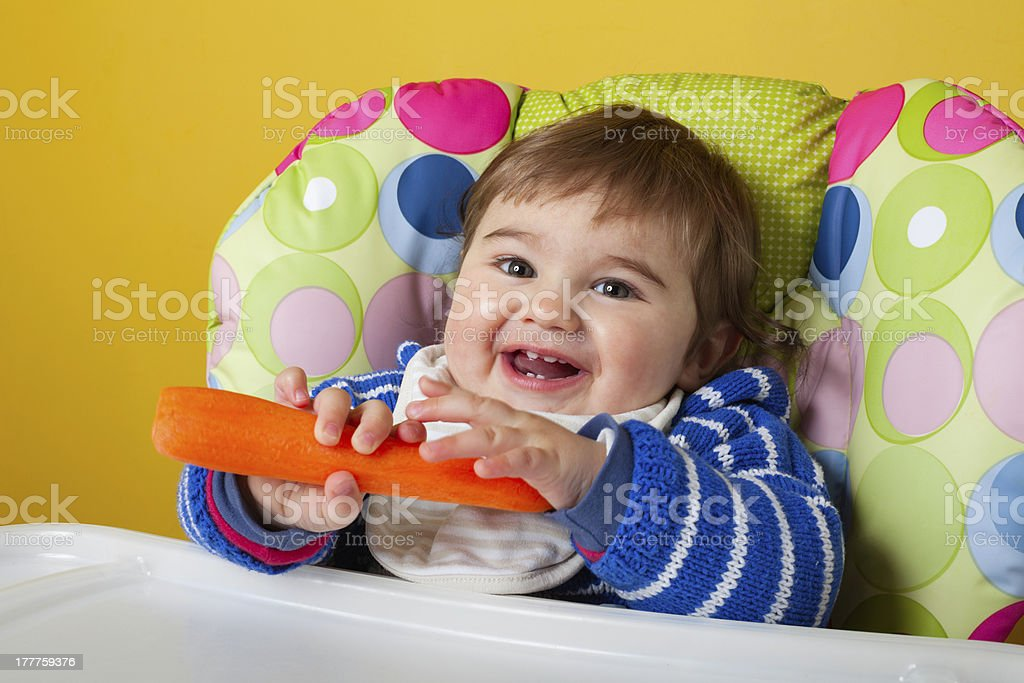 Baby boy with carrot royalty-free stock photo