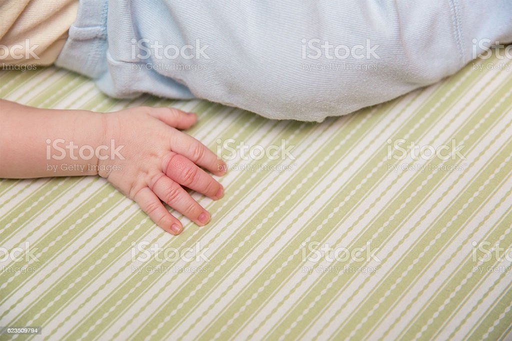 Baby Boy With Finger Injury stock photo