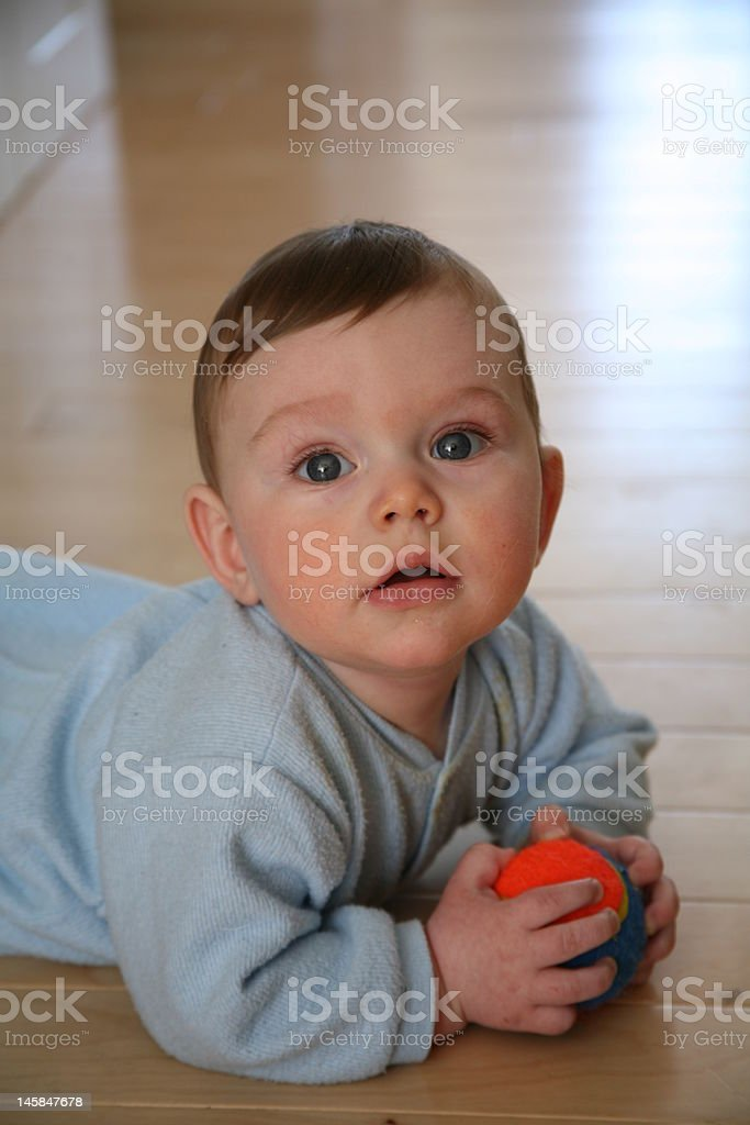 Baby boy with his ball royalty-free stock photo