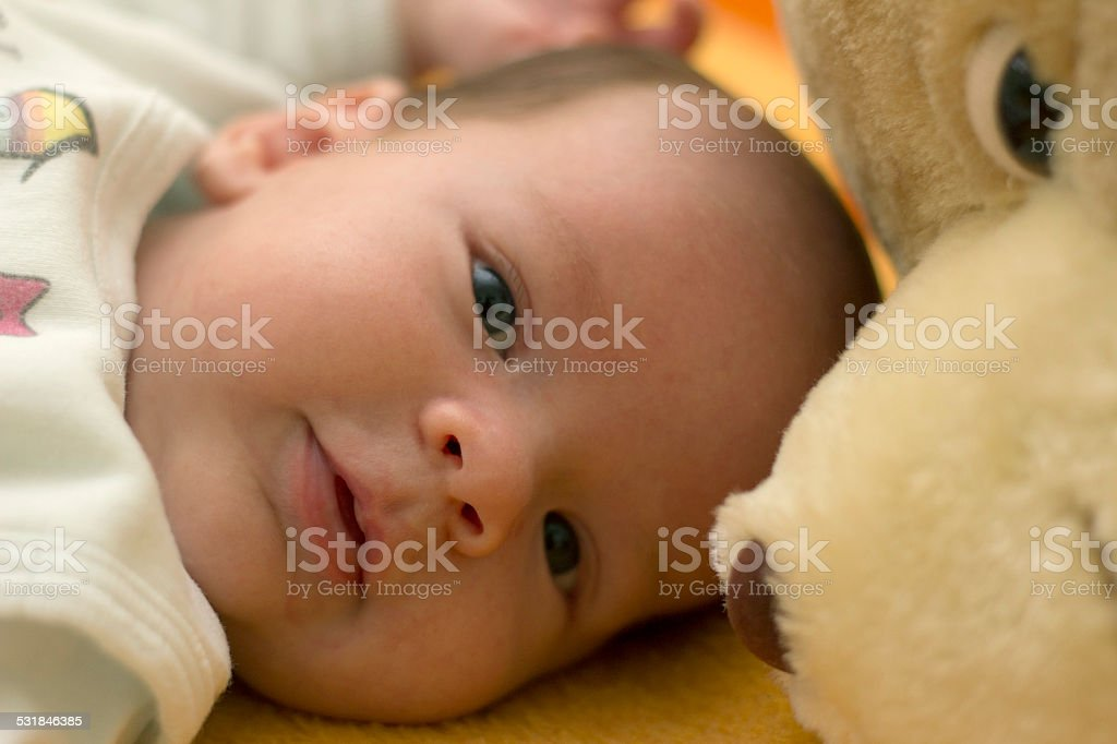 baby boy with his favorite teddy bear stock photo