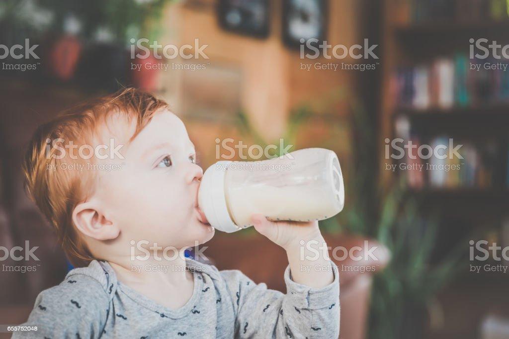 Baby Boy With Milk Bottle stock photo