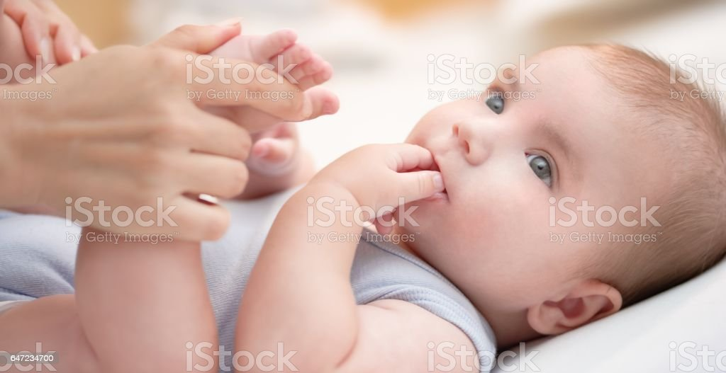 Baby boy with mother stock photo