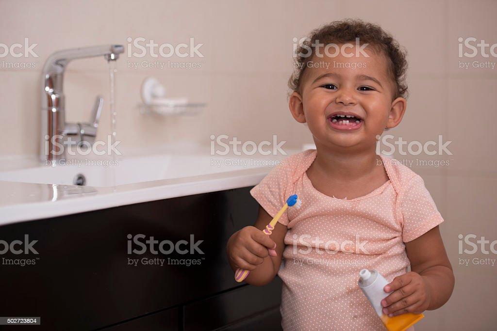 Baby brushing teeth. stock photo