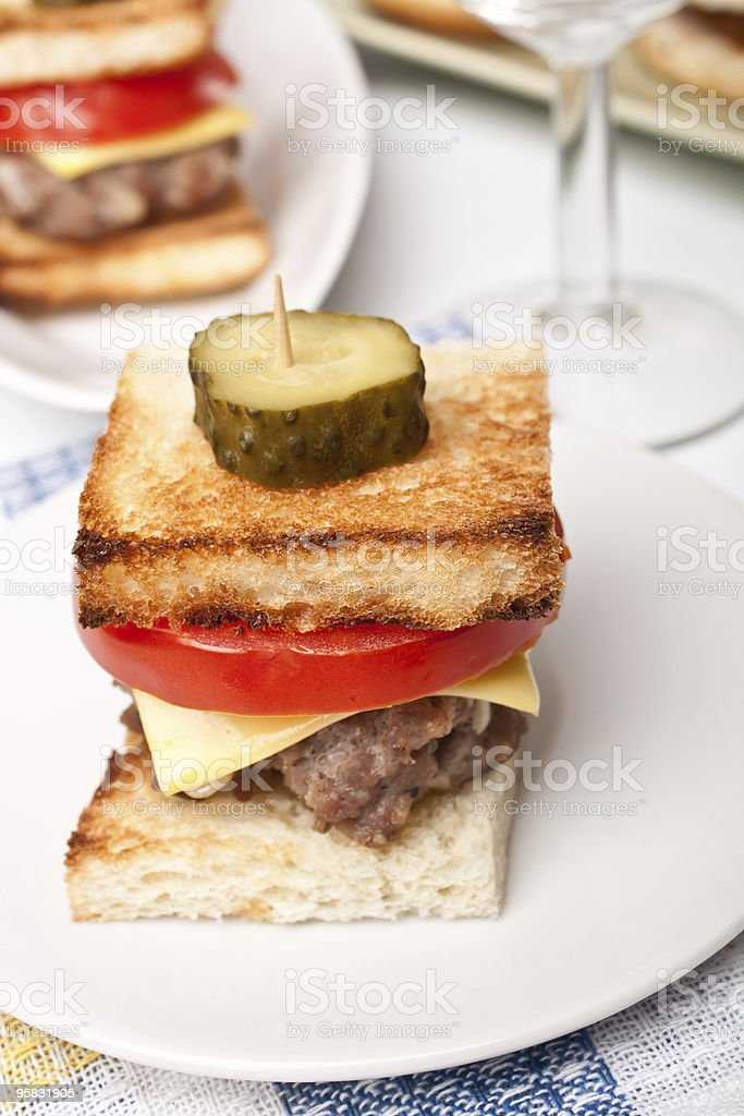 baby burger on a white plate royalty-free stock photo