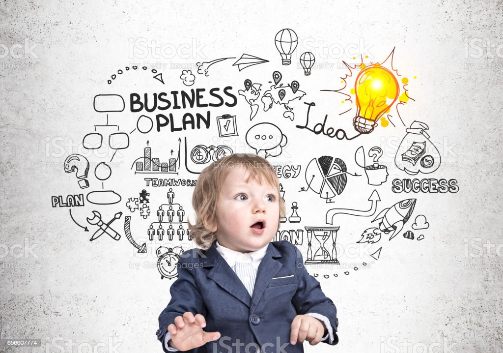 Baby businessman and business plan stock photo