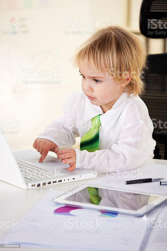 Baby businessman working on laptop royalty-free stock photo