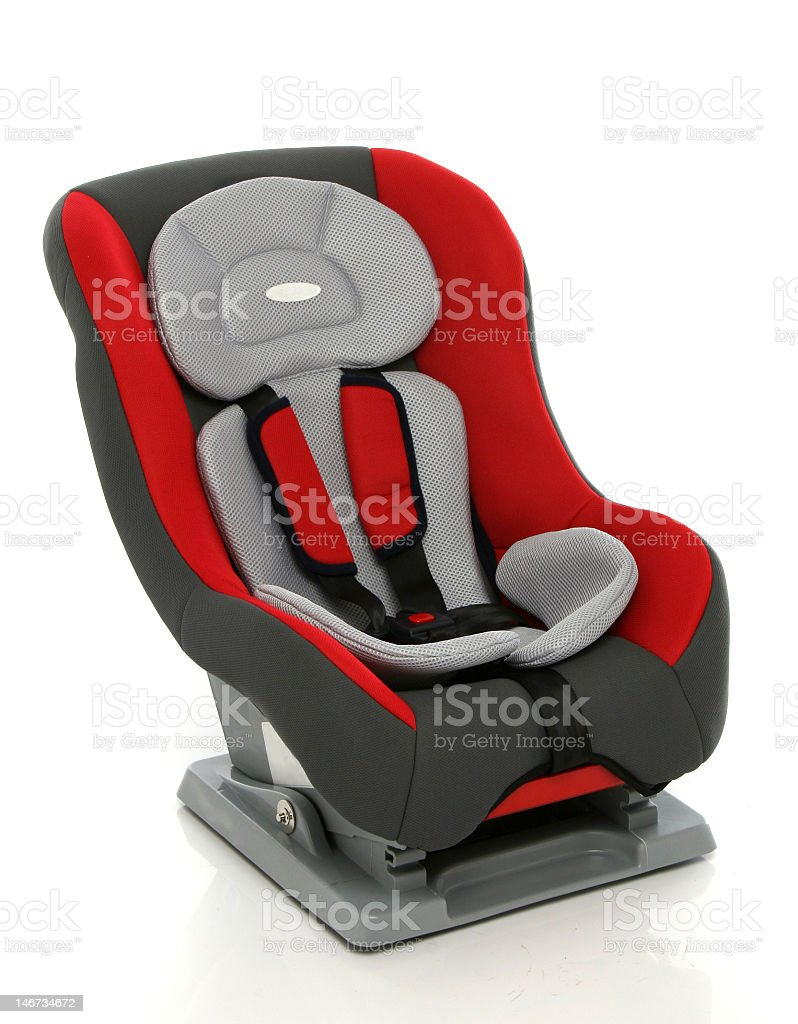 Baby car seat in red and gray on white background stock photo