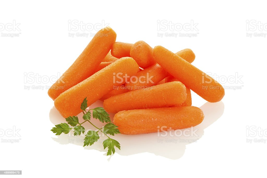 Baby Carrots on white background stock photo