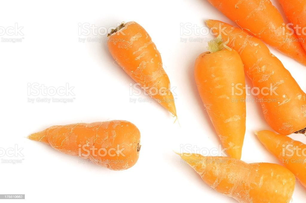 Baby carrots scattered stock photo
