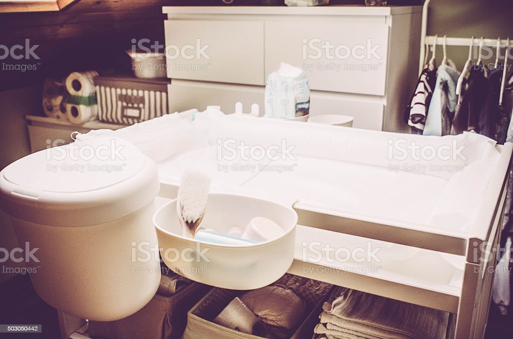 Baby changing table stock photo