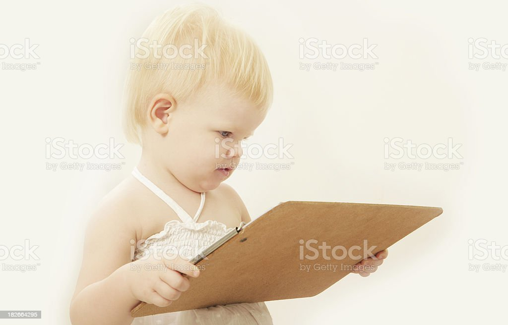 Baby Checking the Facts royalty-free stock photo