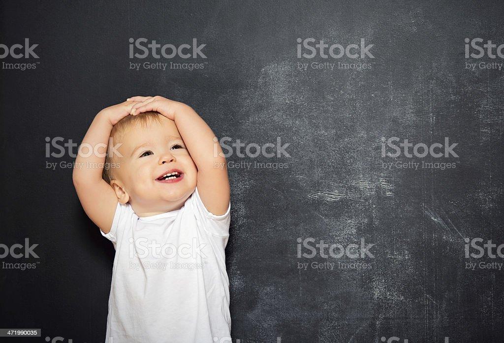 baby child and empty Blackboard stock photo