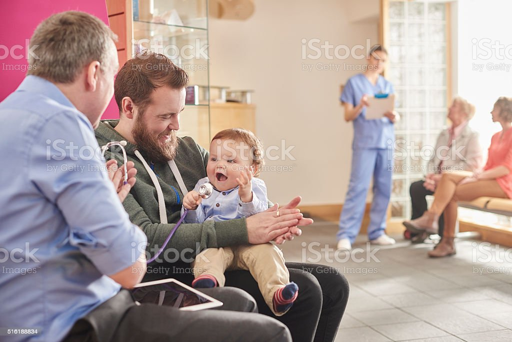 baby clinic dad stock photo