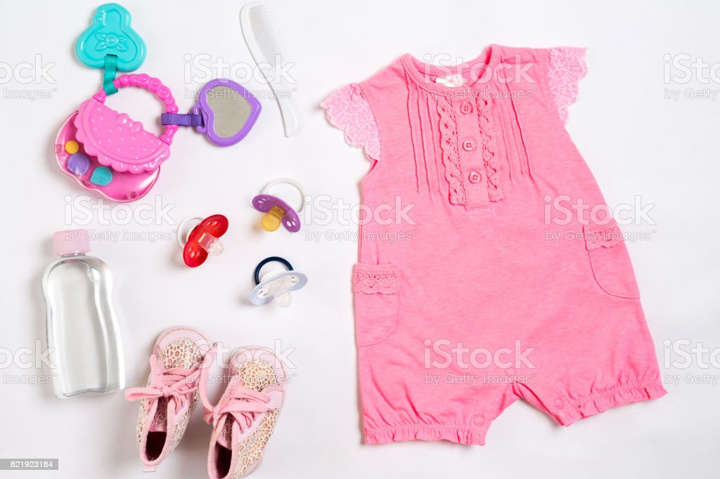 Baby clothes and accessories on white background. Top view stock photo