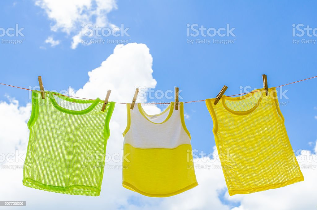 Baby clothes laundry hanging on the clotheline stock photo