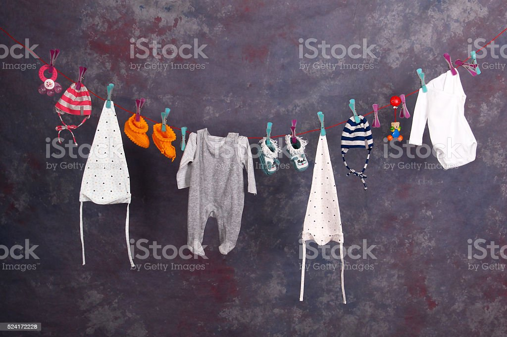 Baby Clothes on a clothesline stock photo