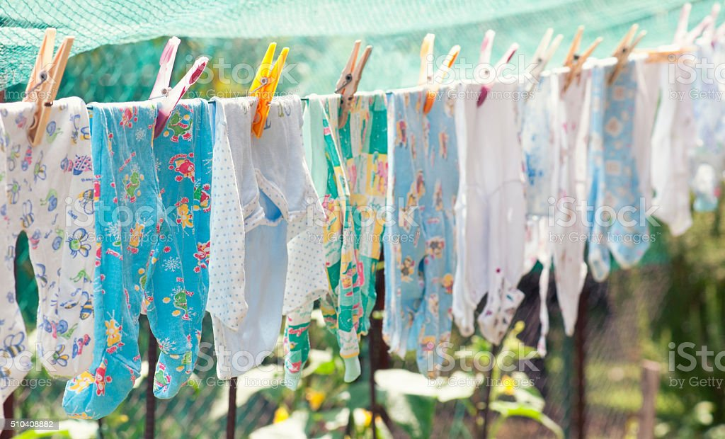 Baby Clothes on the Clothesline stock photo