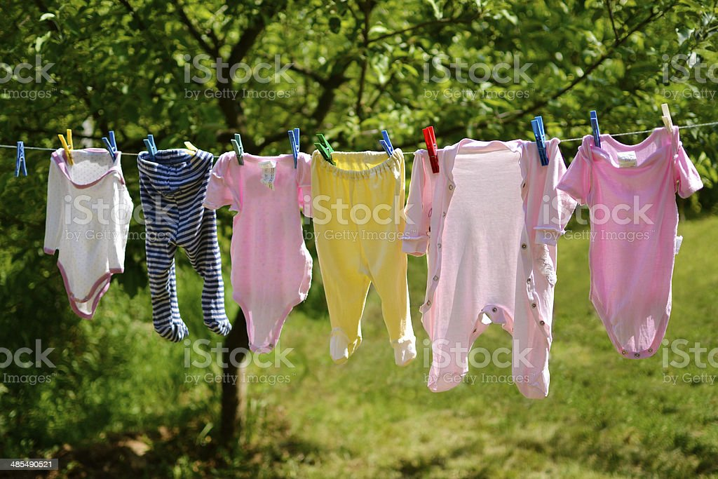 Baby clothes on the washing line stock photo