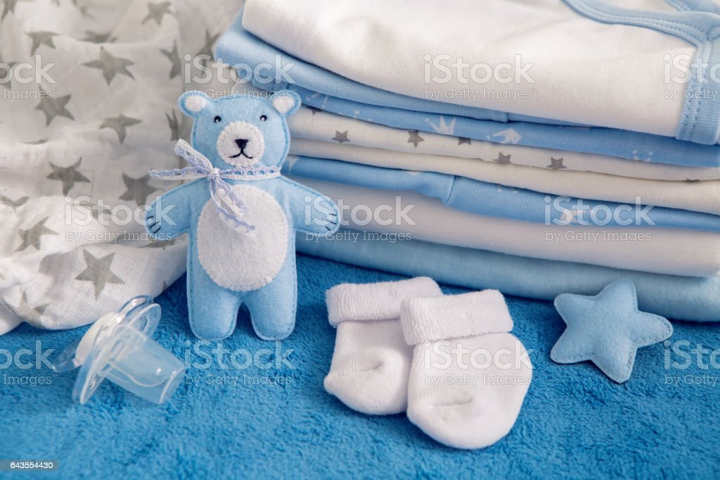 baby clothes with diapers are stacked stock photo