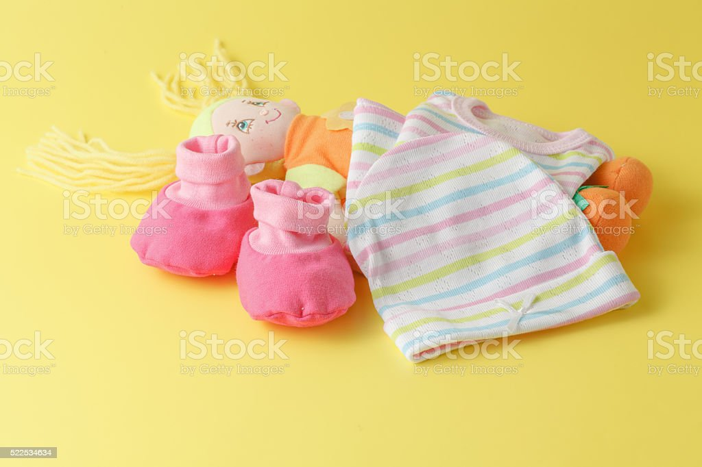 Baby clothing and doll stock photo