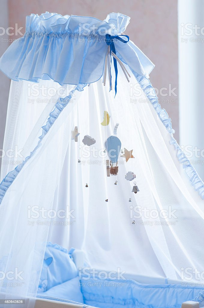 Baby cot  with toys. stock photo