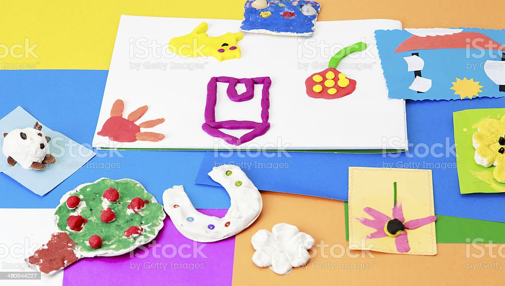 baby crafts from play dough and colourful paper stock photo