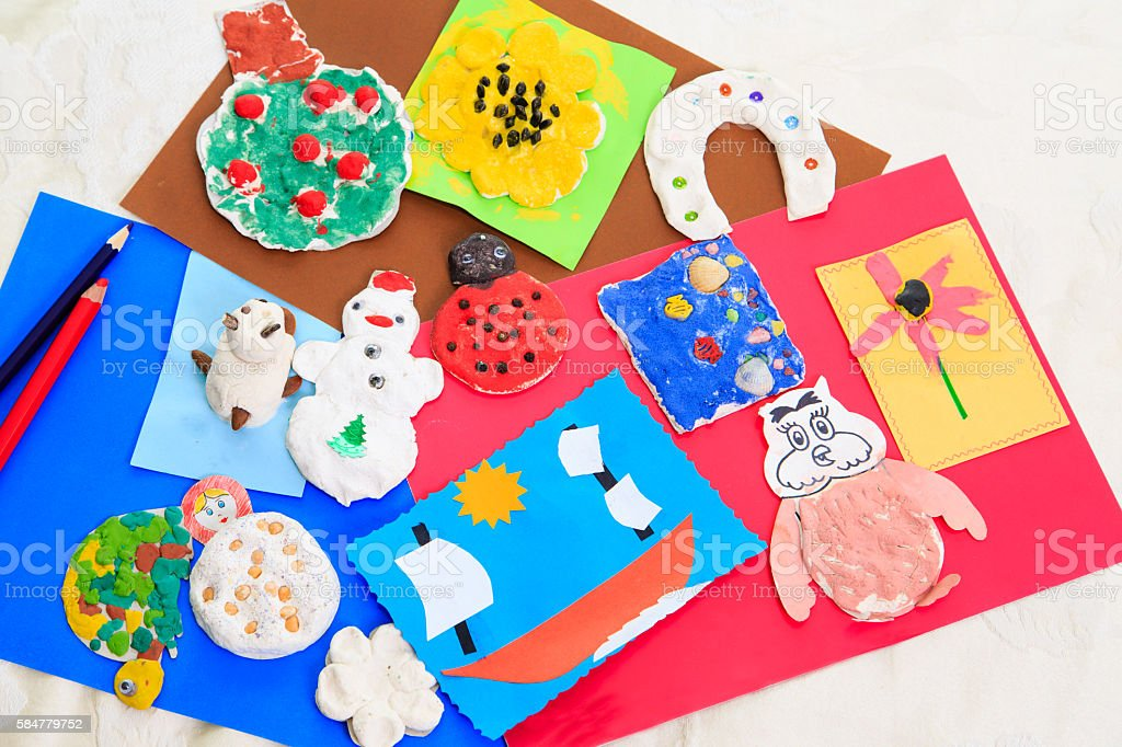 baby crafts from play dough and paper, early eduction stock photo