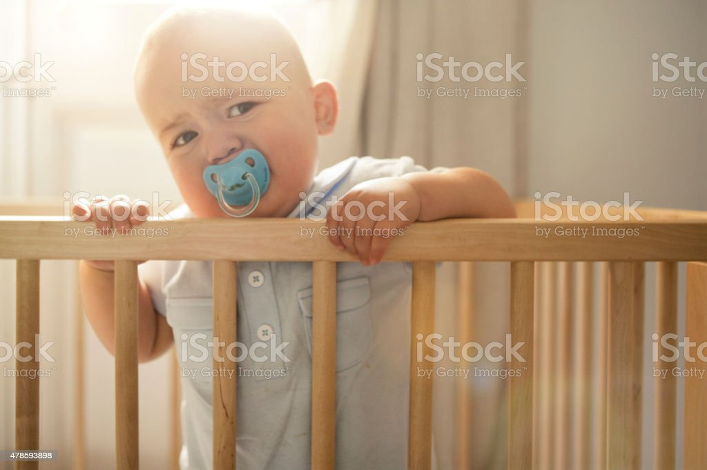 Baby cring in his crib stock photo