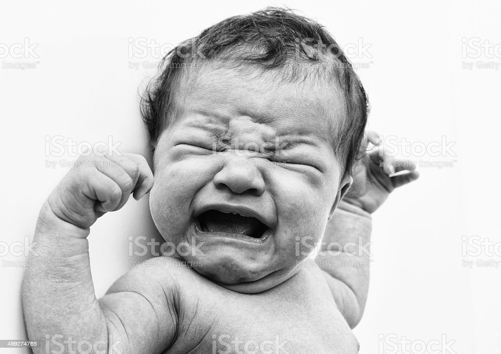 Baby crying out loud stock photo