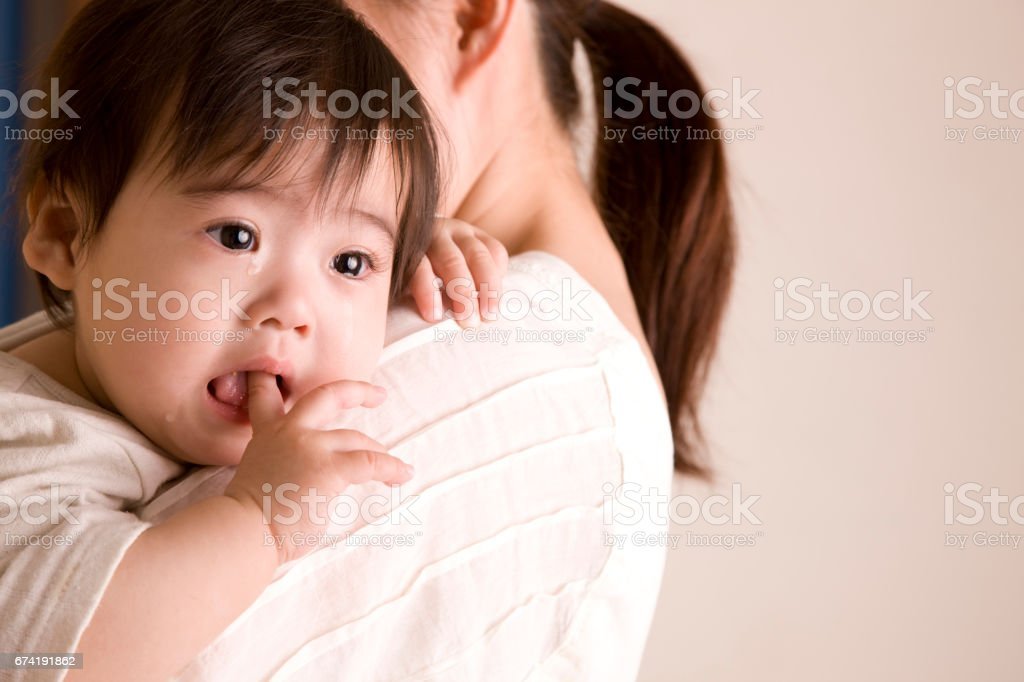 Baby crying while 銜e fingers stock photo