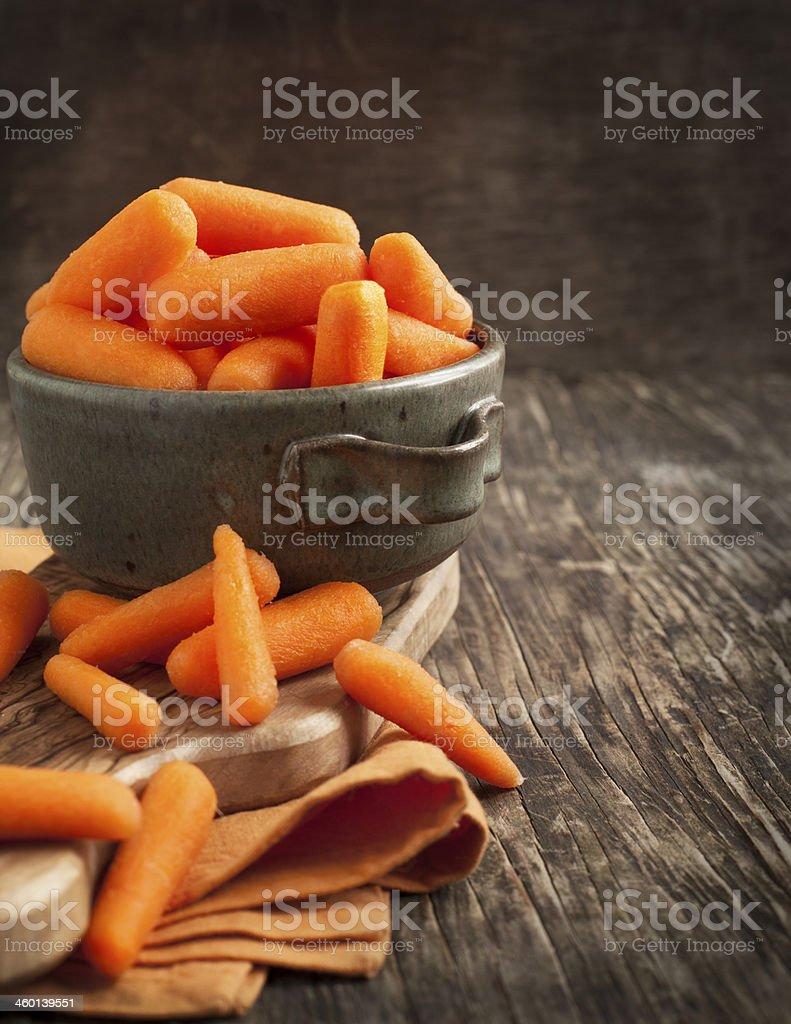 Baby cut carrots stock photo