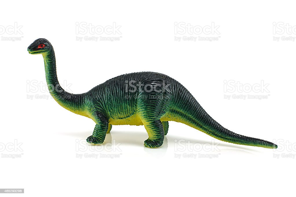 Baby dinosaur yellow color toy figure model stock photo