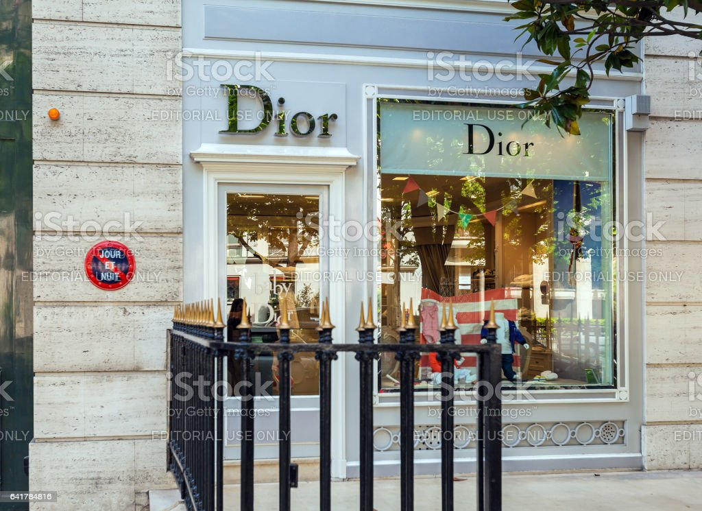 Baby Dior boutique kids dress store stock photo