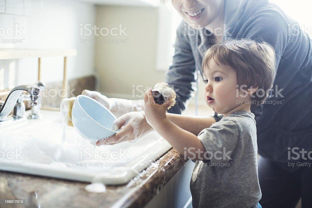 Baby Dish Washing stock photo