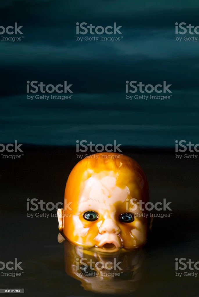 Baby Doll in an Oil Slick royalty-free stock photo