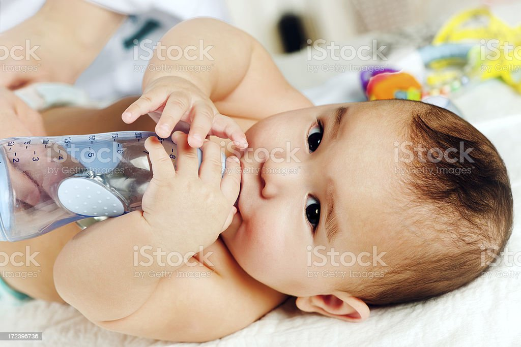 Baby drinking royalty-free stock photo