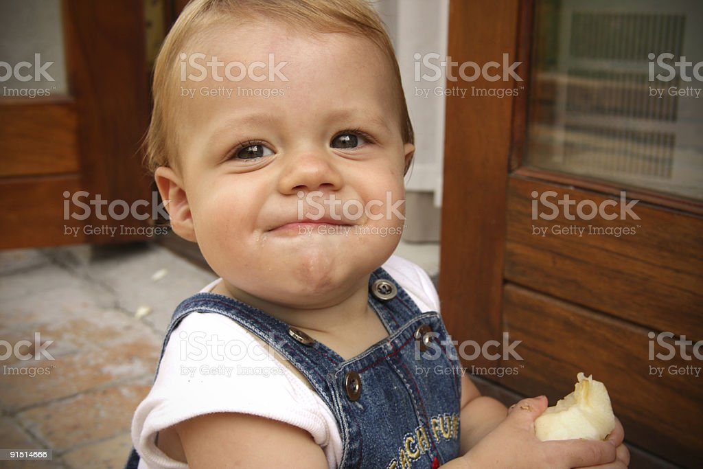 Baby eating a pear royalty-free stock photo
